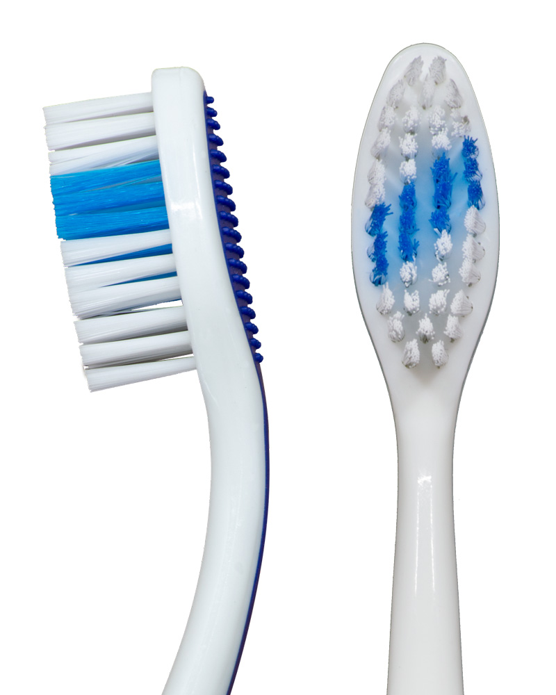 "Closeup of the profile and straight-on views of the Blue ""Selfie"" Standard manual toothbrush from Toothbrushery.com. The brush handle is white with a blue grip on the back. The bristles are white and blue, with the blue portion being a diagonal stripe across the middle of the bristles."
