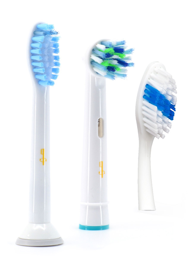 "Three brush heads from Toothbrushery.com arranged by descending height from left to right, each with a different pattern of blue and white bristles. The first brush head is the Acousto replacement for Sonicare, the second is the Oscillo brush head replacement for Oral B and the third is the ""Selfie"" Toothbrushery.com brand manual toothbrush."